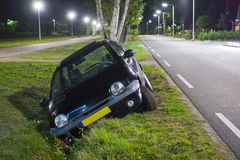 Car in ditch stock image
