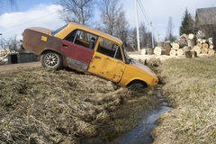 Car in a ditch Royalty Free Stock Photos