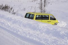 Car in ditch after winter accident. Vehicle loses control and drove off road at ice. Car in ditch after winter accident. Vehicle loses control and drove off road stock photography