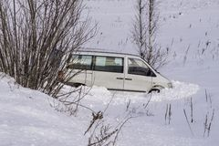 Car in ditch after winter accident. Vehicle loses control and drove off road at ice. Car in ditch after winter accident. Vehicle loses control and drove off road royalty free stock photography