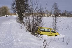 Car in ditch after winter accident. Vehicle loses control and drove off road at ice. Car in ditch after winter accident. Vehicle loses control and drove off road royalty free stock photos