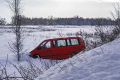 Car in ditch after winter accident. Vehicle loses control and drove off road at ice. Car in ditch after winter accident. Vehicle loses control and drove off road stock images