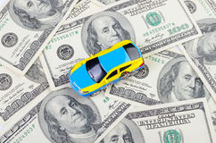 Car on the dollar bill Stock Photography