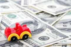 Car on dollars Royalty Free Stock Photos