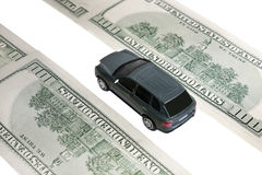 Car among dollars Royalty Free Stock Image