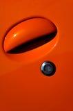Car door. A detail of an orange sports car Royalty Free Stock Image