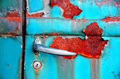 Car door. Rusted car door with silver handle Royalty Free Stock Image