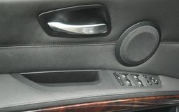 Car door. Door and window controls on interior car door panel royalty free stock images
