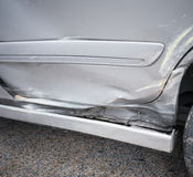 Car door damaged by accident Royalty Free Stock Image