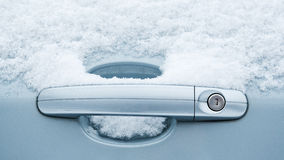 Car door handle and frozen snow Royalty Free Stock Photography