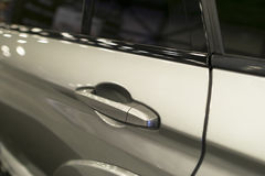 Car door handle of a modern car with car exterior details Royalty Free Stock Photo