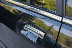 Car door handle from outside. Stock Photos