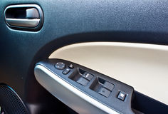 Car door handle and window switch Royalty Free Stock Photography