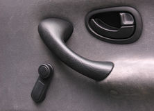 Car door handles. Classic car door equipment. No electronics, buttons. Only handles and grips. Passenger side Stock Photos