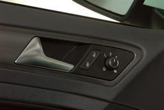 Car door handles and electric detail. The inside of the car Royalty Free Stock Photos