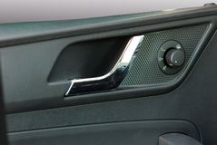 Car door handles and side mirror switch control Royalty Free Stock Photo