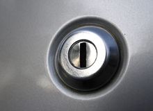Car door lock keyhole. Key hole on an automobile car door locking device Stock Images