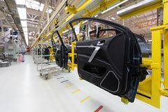 Free Car Door On Conveyor. Robotic Equipment Makes Assembly Of Car. Modern Car Assembly At Factory Stock Images - 134223354