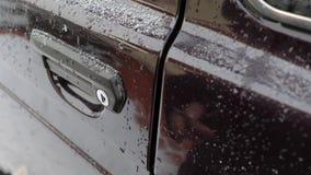 Car door opening. Opening the door of an old car in snowy weather stock video