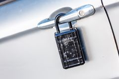 Car door with padlock icon for theft protection, security, protection royalty free stock photography
