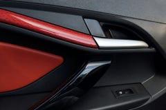 Car door panel closeup. luxury car interior from the inside. Door handle royalty free stock image