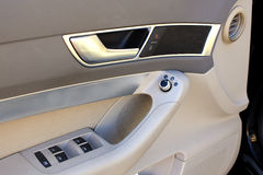 Car door with window buttons and locks Stock Photos