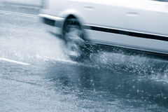 Car in a downpour Stock Images
