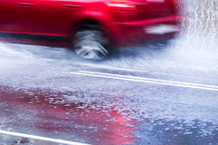 Car in a downpour Royalty Free Stock Photo