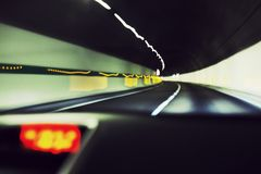 Car speeding in tunnel expressway Royalty Free Stock Photography