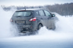 Car drift and spray snow Royalty Free Stock Photography