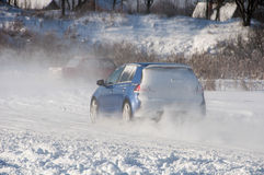 Car drift spray the snow Royalty Free Stock Photo