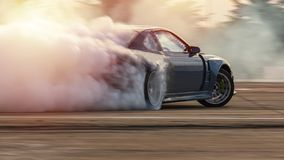 Free Car Drifting, Blurred  Image Diffusion Race Drift Car With Lots Of Smoke From Burning Tires On Speed Track Stock Photo - 158610190