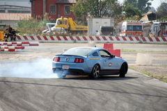 Car drifting. A competition of drifting at Super Car Roma auto show 2014 Royalty Free Stock Photography