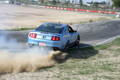 Car drifting. A competition of drifting at Super Car Roma auto show 2014 Royalty Free Stock Photos