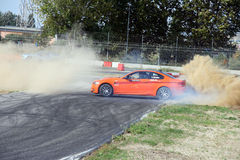 Car drifting. A competition of drifting at Super Car Roma auto show 2014 Royalty Free Stock Images