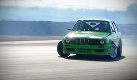 Car drifting on race track. During a drift competition Royalty Free Stock Images
