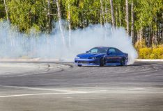 Car drifting on speed track Stock Photo