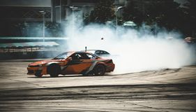 Free Car Drifting, Sport Car Wheel Drifting And Smoking On Blurred Background. Motorsport Concept Royalty Free Stock Photo - 161077735