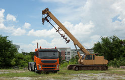 Car drilling drawbar trailer towing yellow-orange. Cranes and drilling to construction Stock Photo