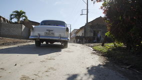 Car from 1950 drive on country road stock footage