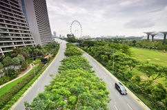 Car drive by the road in front of Marina Bay Sands Stock Image