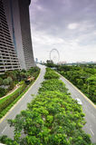 Car drive by the road in front of Marina Bay Sands Stock Photo