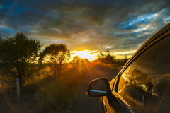 A car drive to the sunset Stock Photo