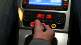 Car driver change gear. Digital dashboard in car. Gear shift in auto. Man`s hand switches manual transmission in car. Digital dashboard in car. Touchscreen stock video