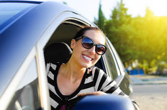 Car driver happy. Woman drives a car on the road and smiling Stock Photo