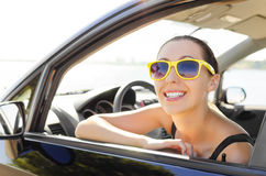 Car driver happy. Woman drives a car on the road and smiling Royalty Free Stock Photo