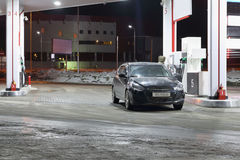 Car and driver on petrol station Stock Image