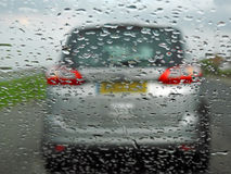 Car driver restricted view. Photo of a car driver driving in bad weather causing restricted view on windscreen Stock Image