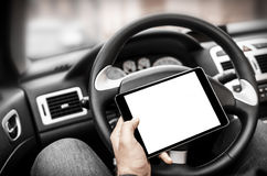 Car driver with the Tablet PC Stock Photo