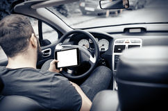 Car driver with the Tablet PC Stock Photos